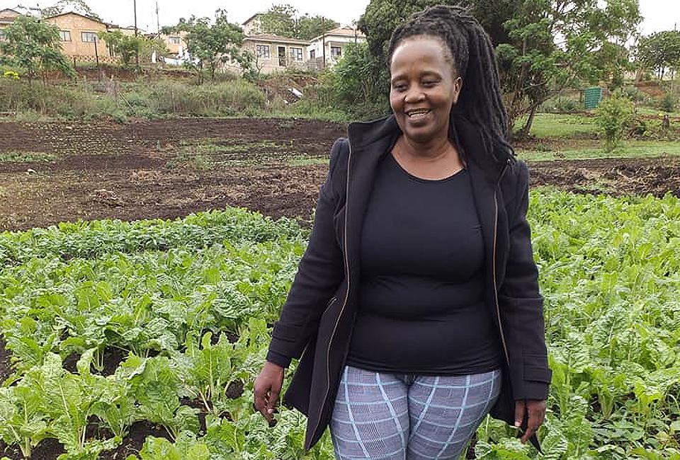 Plant whisperer, cancer survivor & community farmer